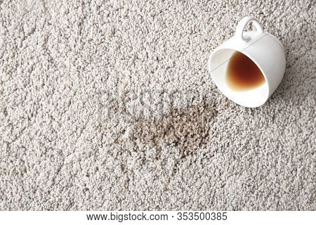 Cup Of Coffee Spilled On A Carpet