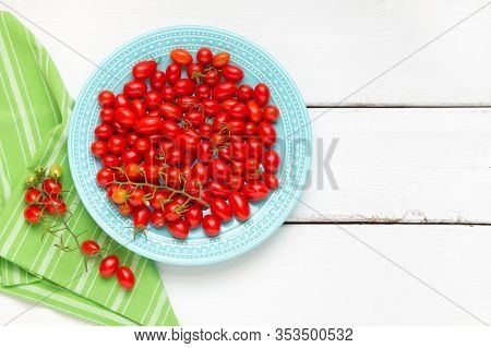 Home Grown Cherry And Grape Tomatoes On Plate.