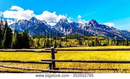 Fall Colors And The Tall Mountain Peaks Of Middle Teton, Grand Teton, Mount Owen And Teewinot Mounta