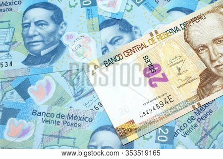 A Close Up Image Of A New, Peruvian Twenty Sol Bank Note Close Up On A Bed Of Mexican Twenty Peso Ba