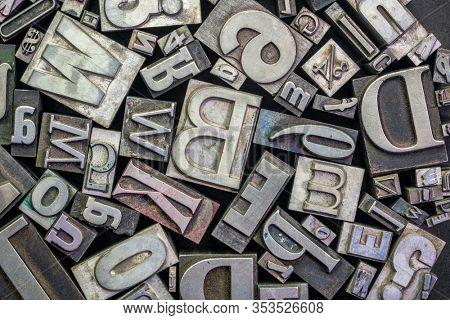 background of random vintage grunge letterpress metal type printing blocks