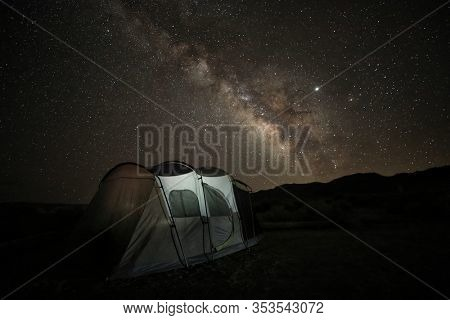 Camping at Night Under the Stars and Milky Way