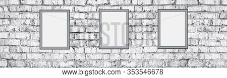 Blank Photo Frames On Rough Light Gray Brick Wall