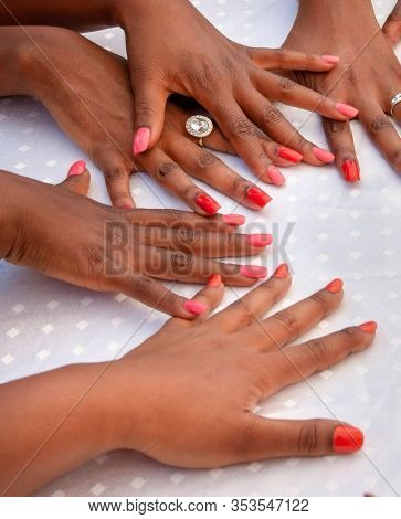 group of young African woman showing their fingernails