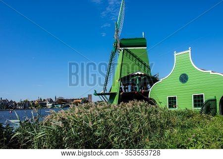 Zaanse Schans, Netherlands - 1 October 2019: Traditional Dutch Windmill In Zaanse Schans, A Typical