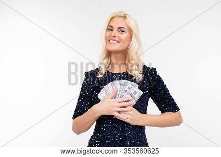 Portrait Of A Successful Woman In A Dress Holding A Bunch Of Money In Her Hands On A White Backgroun