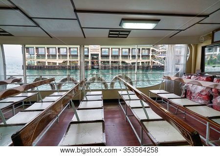 HONG KONG, CHINA - CIRCA JANUARY, 2019: inside a Star Ferry boat in Hong Kong. The Star Ferry is a passenger ferry service operator and tourist attraction in Hong Kong.