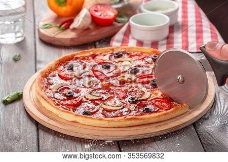 Hot Homemade Pepperoni Pizza. Close Up. Creative Photo.