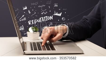 Businessman working on laptop with REPUTATION inscription, modern business concept