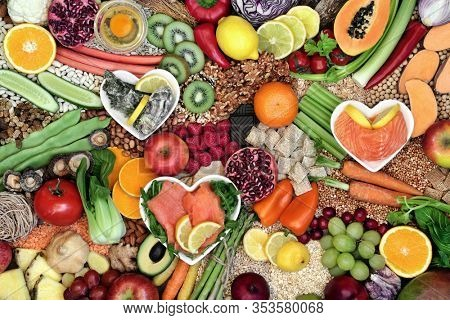 Health food for a healthy diet with foods high in antioxidants, anthocyanins, lycopenes, vitamins, protein, omega 3, fibre &  minerals. Flat lay, top view.