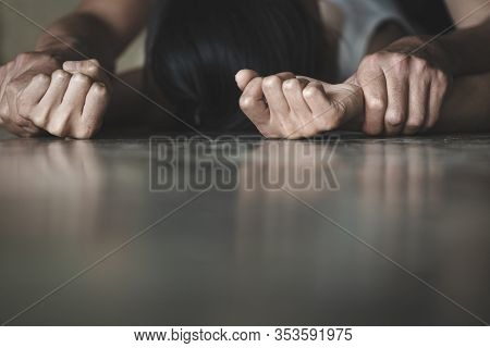 Man's Hand Holding A Woman Hand For Rape And Sexual Abuse,  Hands For Rape And Sexual Abuse Concept,