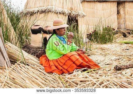 Uros, Peru- Jan 5, 2019: Inhabitant of Uros floating islands, Titicaca lake, Peru.