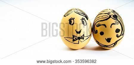 Faces Of Men And Women Drawn On Chicken Eggs. Gender Equality, Neutrality. Man And Woman Dominate, P