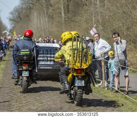 Wallers,france - April 12,2015: Rear View Of Three Technical Vehicles Driving On A Cobblestone Road