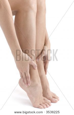Woman Rubbing Her Foot