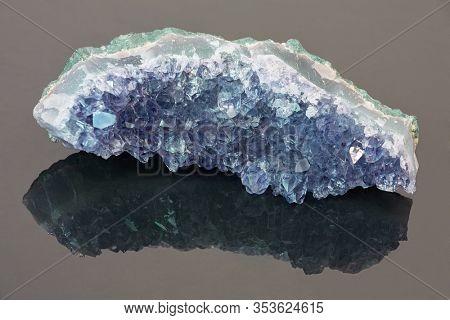 macro photo of blue sapphire druse on dark background