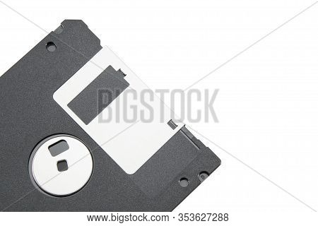 Part Of An Old Black Floppy Disk For An Fdd Drive. Digital Vintage Drive. 1.44 Megabyte Retro Data W