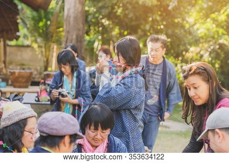Lamphun Thailand - December 12 :  Unidentified Thai Female Tourists Learn To Make A Necklace From A