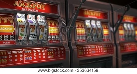 Slot machines row in a casino. Onliine casino and gambling concept background. 3d illustration