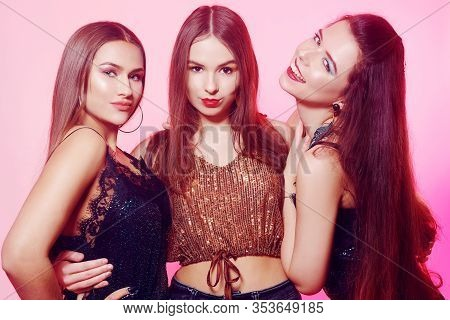 3 Girls Pose, Make Faces, Show Tongue. Girls In Brilliant Dresses With Different Colorful Makeup. Th