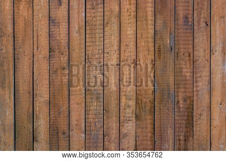 Aged Striped Fence Of Wooden Textured Planks. Brown Wood Countryside Fence. Natural Wooden Surface I