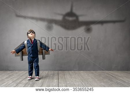 Hapy Child Wants To Become A Pilot. Funny Kid Dreams Of Becoming A Aviator. Imagination And Motivati