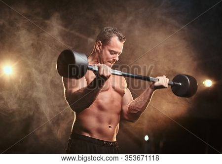 Powerful Mucular Sportsman, Looking Tense, Doing Weightlifts With Barbell And Looking Concentrated I