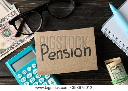 Pension Concept With Inscription Pension On Wooden Background, Top View