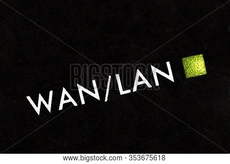 Macro close up photograph of wan and lan modem router indicator light.
