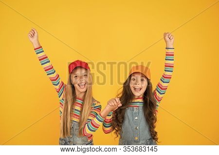 Winners Reaching Their Goal. Excited Little Children Making Winner Gestures On Yellow Background. Cu