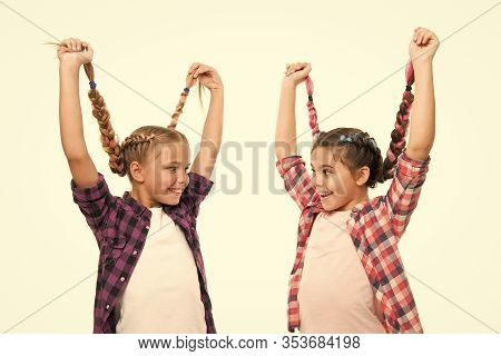 Create Simple But Gorgeous Hairstyle. Happy Children Wear Plaited Hairstyle. Small Cute Girls Hold L