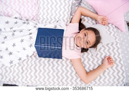 Must-have Encyclopedia For Every Library. Happy Girl Read Encyclopedia In Bed. Small Child With Ency