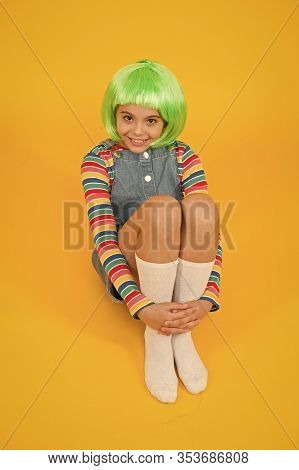Creating Fancy Look. Happy Child With Slick Look Of Green Hair Wig. Beauty Look Of Small Fashion Mod