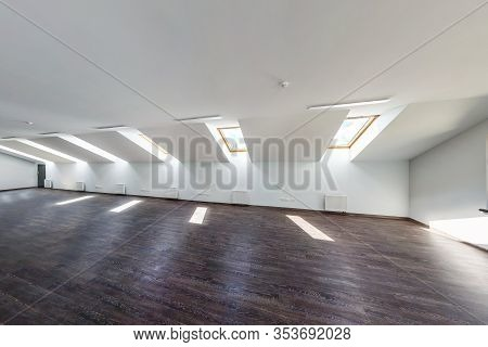 Empty Unfurnished Loft Mansard Room Interior With Wooden Columns And Wet Concrete Floor On Roof Leve