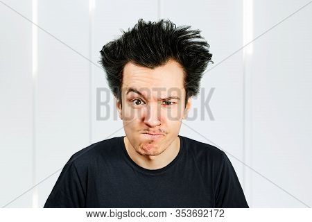 Long Hair Guy Offended And Matures On A White Background