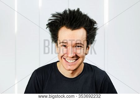 Shaggy Mad Young Guy Freak With Long Hair, Smiling On White Background.