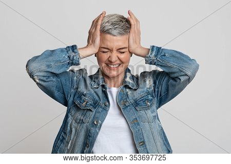 Headache Concept. Sick Mature Woman Touching Her Temples, Suffering From Migraine Or Stress, Emotion