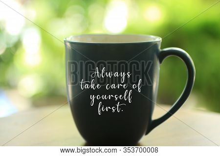 Inspirational Quote - Always Take Care Of Yourself First. With Text On An Empty Cup On Bright Green