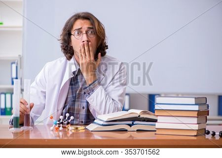 Chemistry lecturer during lecture in college