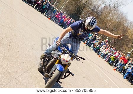 Russia, Rzev - 05.02.2017: A Man Does Stunts On A Motorcycle. Stunt Riding In The Town Square On A F