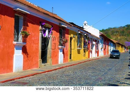 February 25, 2020 In Antigua, Guatemala:  Historical Colorful Spanish Colonial Style Buildings Besid