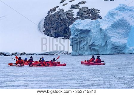 Charlotte Bay, Antarctica - December 26, 2019   Red Kayaks Tourists Glaciers Snow Mountans Charlotte