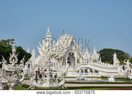 Chiang Rai, Thailand - February.10.2020: Tourists Visit White Temple Rong Khun Temple, Chiang Rai Pr