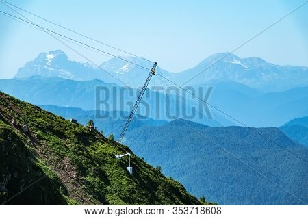 Cableway Pylon In The Mountains. Cable Car Pylon