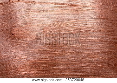 Red copper background texture with particles like scratches. Brush painted surface. Copper red gold pattern background.