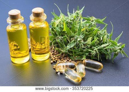 Glass Bottles Containing Hemp Oil, Cbd And Hemp Oil Extractions Black Background, Medical Alternativ