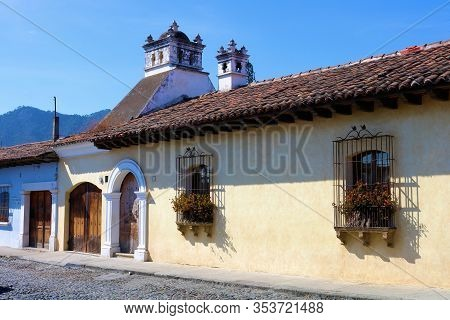 February 25, 2020 In Antigua, Guatemala:  Cobblestone Street Besides Historical Spanish Colonial Bui