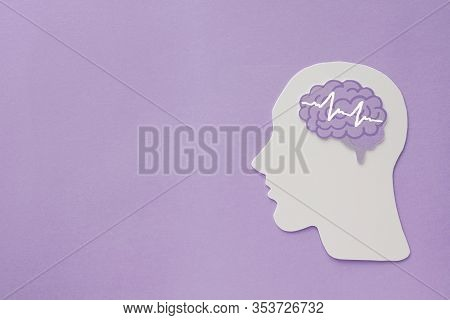 Encephalography Brain Paper Cutout On Purple Background, Epilepsy And Alzheimer Awareness, Seizure D