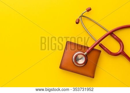 Doctor Stethoscope And The New Leather Brown Men Wallet On Yellow Background. Budget For Health Chec