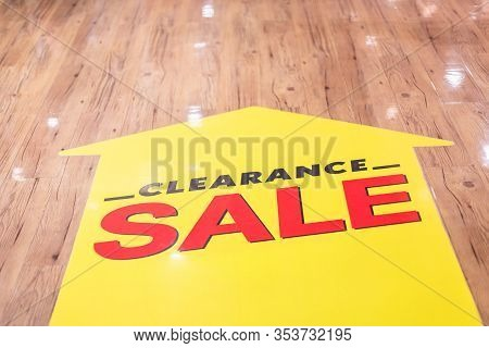 Red Clearance Sale Sticker Set Up On The Ground Floor In Fashion Mall